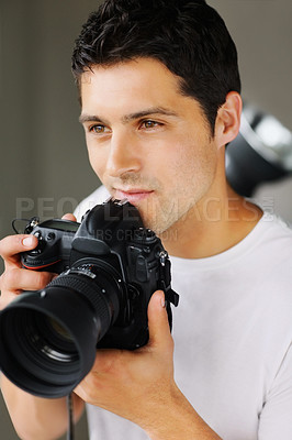 Buy stock photo Confident male photographer looking for something to photograph