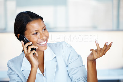 Buy stock photo View of female executive talking on cell phone