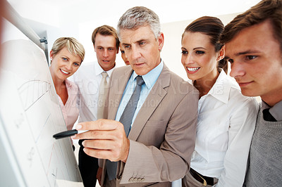 Buy stock photo Senior male speaker giving a presentation at a business meeting in an office