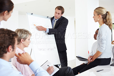 Buy stock photo Successful young male business executive heading a business conference