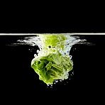 Head of lettuce splashing into water