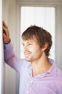 Buy stock photo Handsome young man looking away