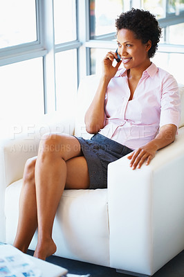 Buy stock photo Attractive business woman busy on cell phone at office