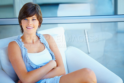 Buy stock photo Portrait of happy pretty woman with hands folded relaxing on couch