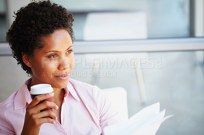 Buy stock photo A young African-American woman with a takeaway coffee looking away thoughtfully