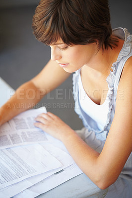 Buy stock photo Portrait of pretty young woman checking the report