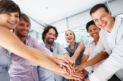 Buy stock photo Portrait of successful business people with hands on top of each other