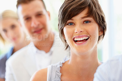Buy stock photo Focus on pretty woman with group in row behind her