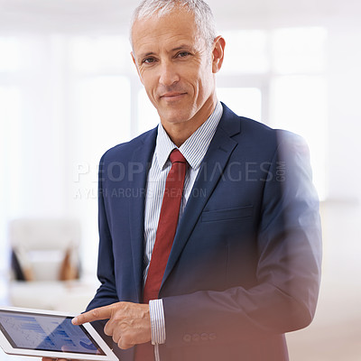 Buy stock photo Cropped shot of a mature businessman looking content and pointing at his tablet
