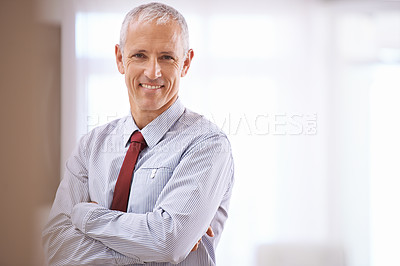 Buy stock photo Portrait of a happy mature business man with his arms folded