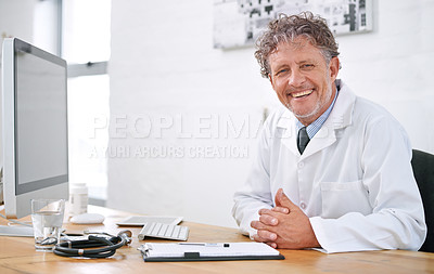 Buy stock photo Portrait of a smiling mature doctor sitting at a desk in his office