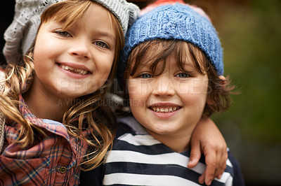 Buy stock photo A portrait of two cute kids standing outdoors on an Autumn day