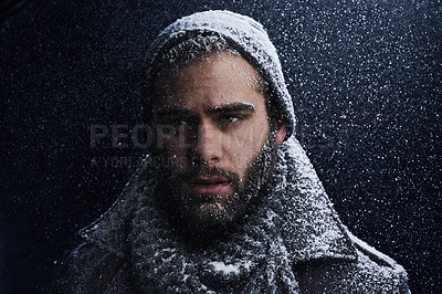 Buy stock photo Cropped shot of a young man in the snow at night