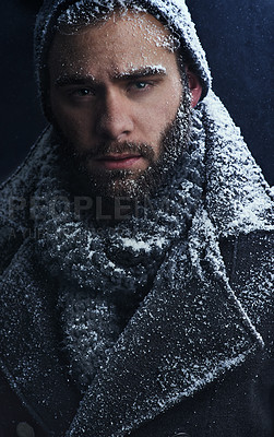 Buy stock photo Cropped shot of a handsome young man covered in snow