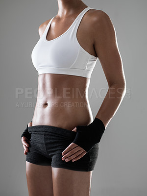 Buy stock photo Cropped shot of a woman dressed in workout clothes