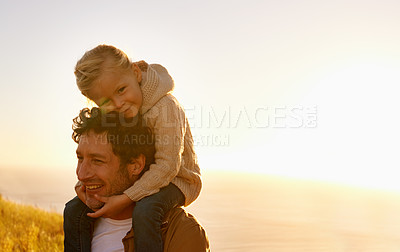 Buy stock photo Cropped shot of a father giving his little girl a ride on his shoulders while on a walk in nature