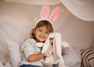 Buy stock photo Portrait of an adorable little girl wearing bunny ears and holding her toy rabbit