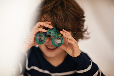 Buy stock photo Shot of an adorable little boy playing with a pair of binoculars