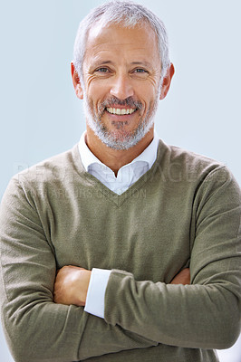 Buy stock photo Portrait of a smiling mature businessman standing in an office