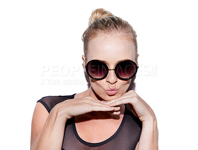 Buy stock photo Portrait of an attractive young woman with sunglasses posing playfully in studio