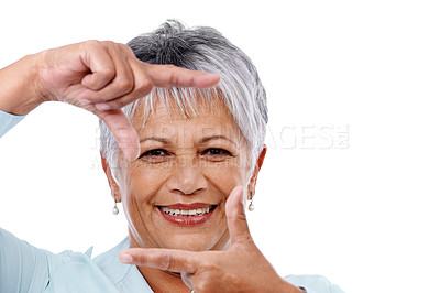 Buy stock photo Studio shot of a mature woman framing her face with her fingers isolated on white