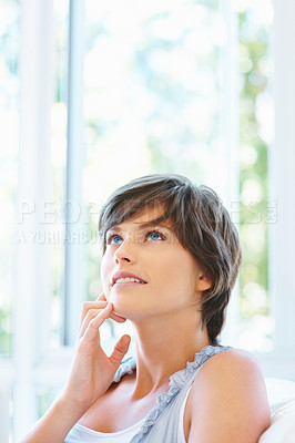 Buy stock photo Pretty woman with hand on face looking up