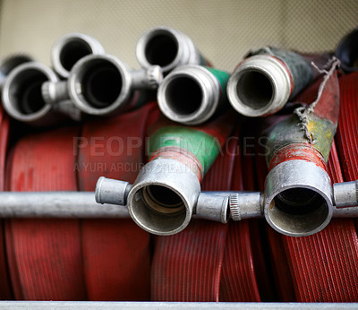 Buy stock photo Cropped shot of a group of fire hoses