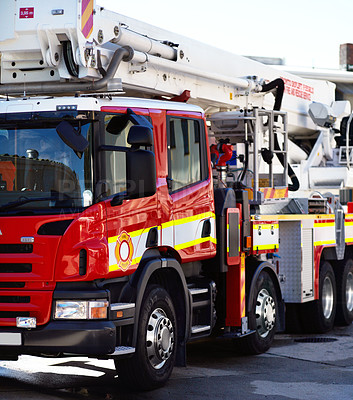 Buy stock photo Shot of a fire engine parked outside a fire station