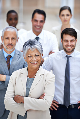 Buy stock photo Portrait of a smiling businesswoman surrounded by a group of her colleagues