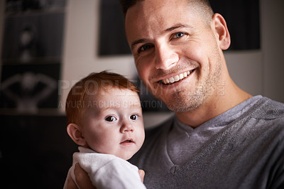 Buy stock photo Shot of a young father holding his adorable baby girl