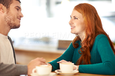 Buy stock photo A cropped shot of a happy young couple on a coffee date