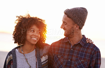 Buy stock photo Shot of a young couple on the beach