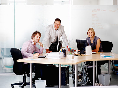 Buy stock photo Leader with his two trainee smiling in board room