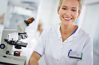 Buy stock photo Portrait of a smiling female researcher sitting at a laboratory