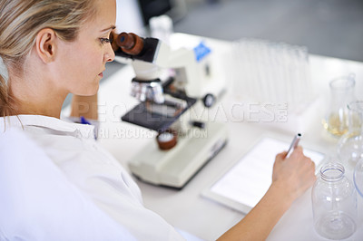 Buy stock photo Shot of a beautiful young scientist recording her findings on a tablet