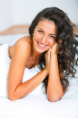 Buy stock photo Happy young woman lying naked in bed