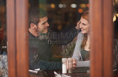 Buy stock photo Cropped shot of an affectionate young couple on a date