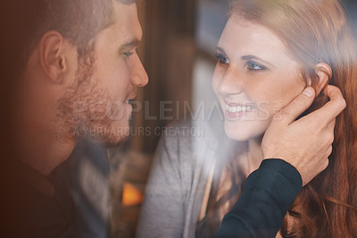 Buy stock photo A cropped shot of a young couple being affectionate