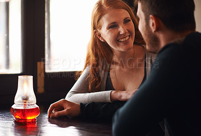Buy stock photo A cropped shot of a young affectionate couple at a coffee shop