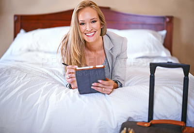 Buy stock photo A young businesswoman using a digital tablet in her hotel room