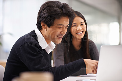 Buy stock photo Shot of two business colleagues working together as a team