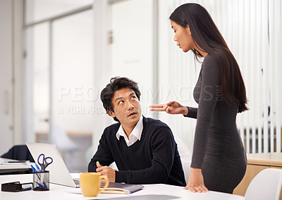 Buy stock photo Shot of two business colleagues discussing work in the office