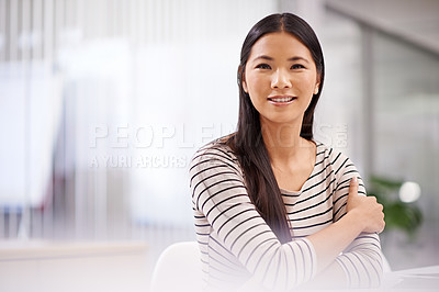 Buy stock photo Portrait of an attractive asian businesswoman sitting in her office