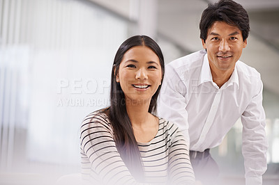 Buy stock photo Portrait of two business colleagues in an office setting