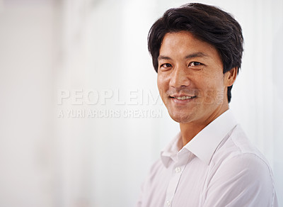 Buy stock photo Portrait of a handsome businessman smiling at the camera