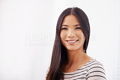 Buy stock photo Portrait of an attractive young businesswoman standing in an office setting
