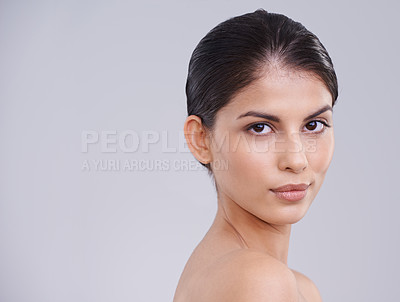 Buy stock photo Cropped studio shot of a beautiful brunette woman against a gray background