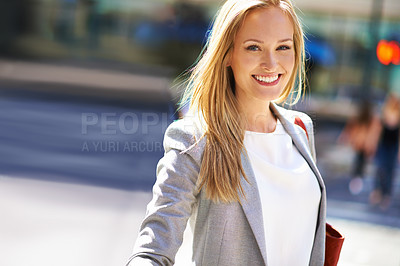 Buy stock photo A beautiful woman walking in the city during the day