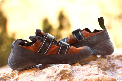 Buy stock photo Climbing shoes lying on a rock outdoors