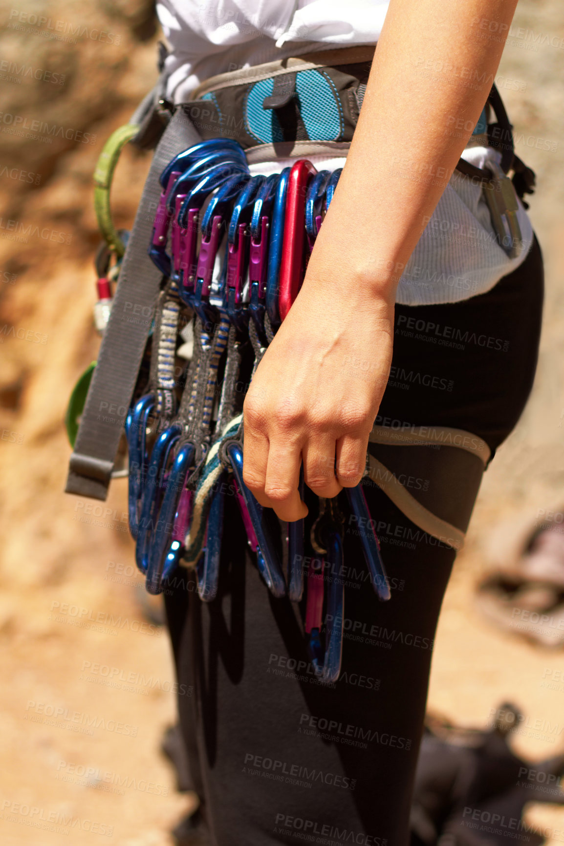 Buy stock photo Carabiners attached to a female rock climber